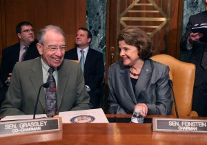 U.S. Sen. Dianne Feinstein (D-CA) (R) and U.S. Sen. Chuck Grassley (R-IA) talk during Senate Caucus on International Narcotics Control hearing on Capitol Hill (Photo by Mark Wilson/Getty Images)