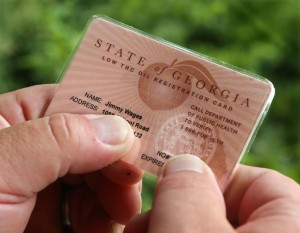 Georgia-issued low-THC oil registration card. Curtis Compton / ccompton@ajc.com